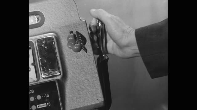 1956 - close-up of man's hand pulling slot machine lever - pulling stock videos & royalty-free footage