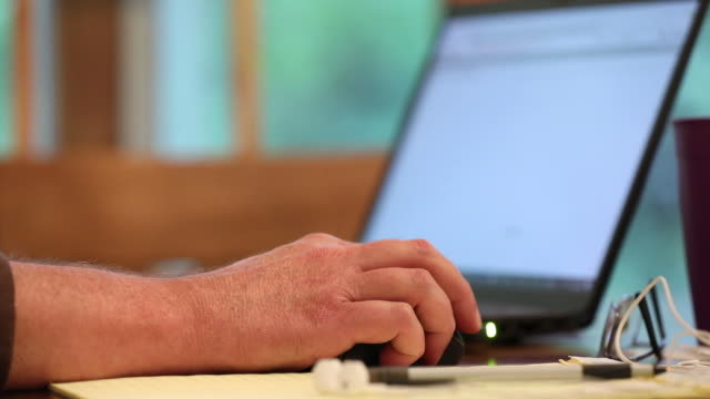 close-up of man's hands working on laptop amid coronavirus pandemic in princeton, il, u.s. on tuesday, september 8. 2020. - using computer stock videos & royalty-free footage