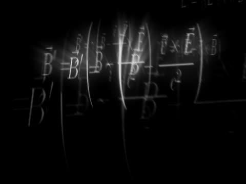 Close-up of mathematical symbols and numbers in motion