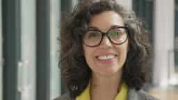Close-up of mature businesswoman in corridor