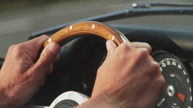 close-up of mature man driving vintage car - steering wheel stock videos & royalty-free footage