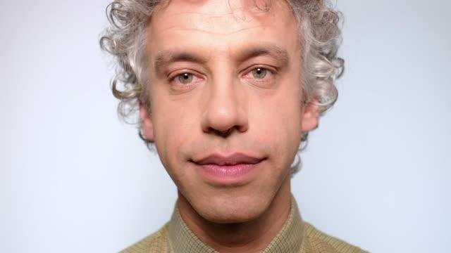 close-up  of mature man staring at camera - nose ring stock videos & royalty-free footage