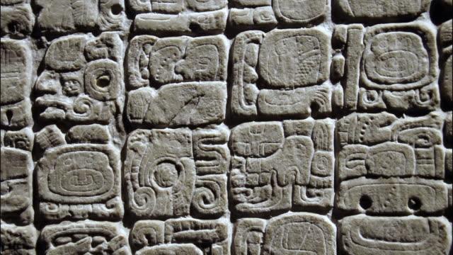 close-up of mayan glyphs - symbol stock videos & royalty-free footage
