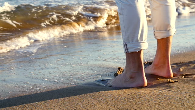 close-up of men foot in the wave. - trousers stock videos & royalty-free footage