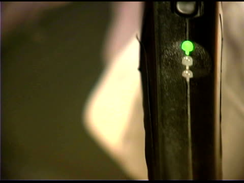 close-up of metal detector wand at airport - metal detector sicurezza video stock e b–roll