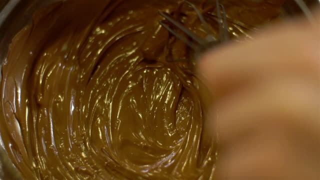 close-up of mixing chocolate dessert, slo mo - wire whisk stock videos and b-roll footage