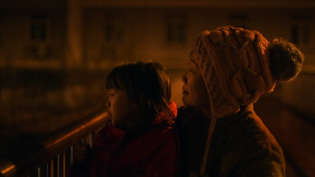 Closeup of Mother and Daughter watching fireworks