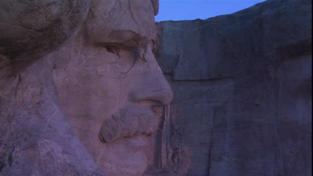 a closeup of mount rushmore focuses on the faces of u.s. presidents roosevelt and lincoln. - south dakota stock videos & royalty-free footage