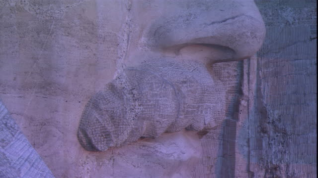 a closeup of mount rushmore focuses on the mustache and eyes of president roosevelt. - mt rushmore national monument stock videos & royalty-free footage
