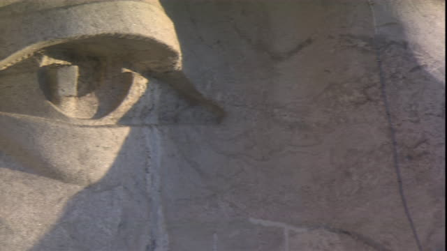a closeup of mt. rushmore focuses on the eyes of u.s. president lincoln. - mt rushmore national monument stock videos & royalty-free footage