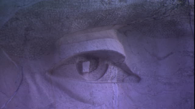 a closeup of mt. rushmore focuses on the face of u.s. presidents roosevelt. - mt rushmore national monument stock videos & royalty-free footage