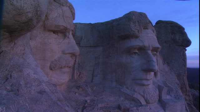 a closeup of mt. rushmore focuses on the faces of u.s. residents roosevelt and lincoln. - monument stock videos & royalty-free footage