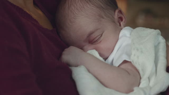 close-up of newborn infant being held by mother - fatcamera baby stock videos and b-roll footage