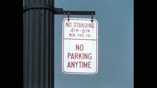 close-up of no parking sign against clear sky - no parking sign stock videos & royalty-free footage