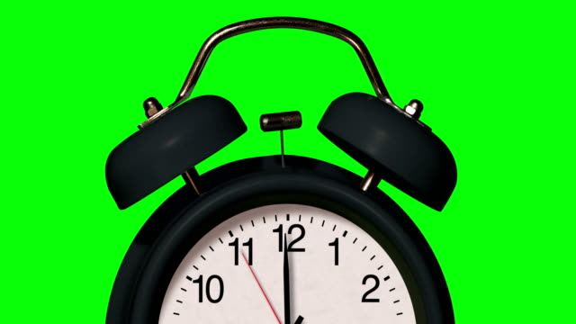 closeup of old fashioned black alarm clock rings on chroma key background - school bell stock videos & royalty-free footage