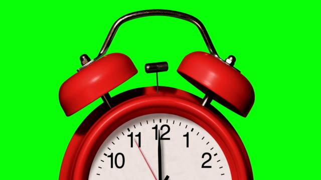 closeup of old fashioned red alarm clock rings on chroma key background - school bell stock videos & royalty-free footage