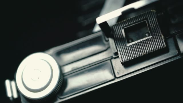 closeup of old retro film camera. - lens eye stock videos and b-roll footage