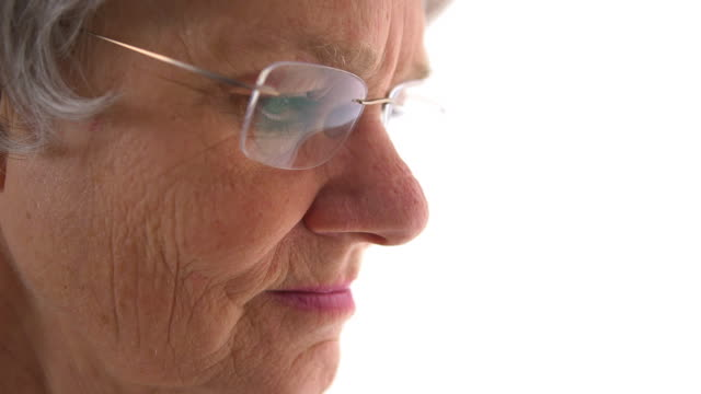 Closeup of old woman looking down