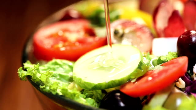 close-up of olive oil pouring into vegetable salad - salad oil stock videos & royalty-free footage