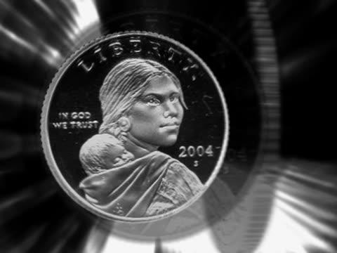 vídeos de stock, filmes e b-roll de close-up of one dollar coins spinning - representação de animal