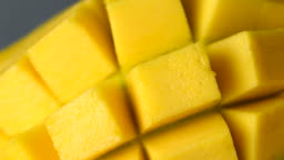 Close-up of open a cut mango in 4K resolution