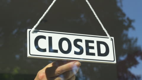 close-up of open/closed sign in store window.store closing. - store stock videos & royalty-free footage