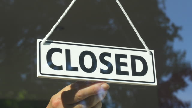 close-up of open/closed sign in store window.store closing. - recession stock videos & royalty-free footage
