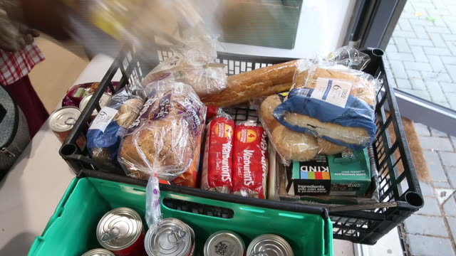 closeup of person arranging food in crate for donation at gascoyne community centre children with voices volunteers prepare meals and arrange donated... - other stock videos & royalty-free footage