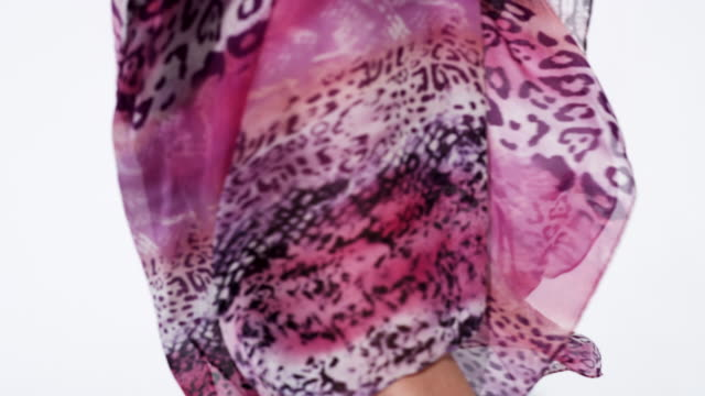 close-up of pink translucent dress swirling around a woman's body as she spins - translucent stock videos & royalty-free footage