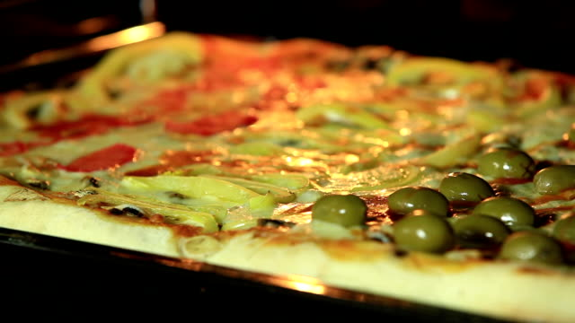 Closeup of pizza cooking