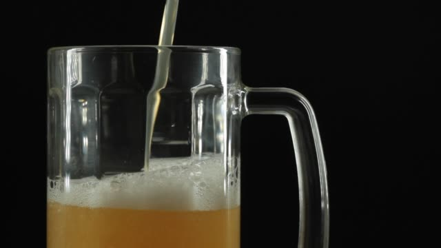 close-up of pouring beer - beer glass stock videos & royalty-free footage