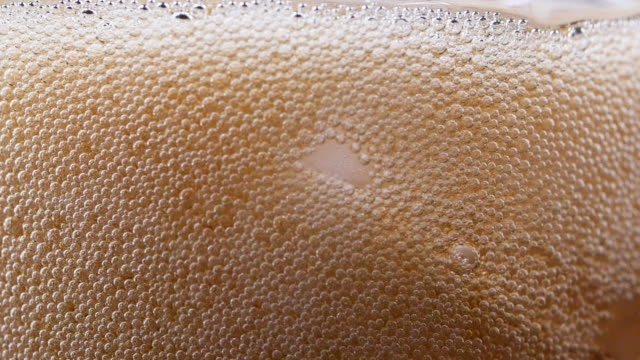 close-up of pouring cold cola with ice cubes and bubbles - frothy drink stock videos & royalty-free footage