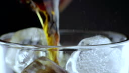 close-up of pouring of fresh coke in the drink glass with ice cubes on black background, fun and summer time concept,three scenes with cut lemon