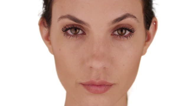 close-up of pretty female on white copy space looking intently at camera alone - eyelash stock videos & royalty-free footage