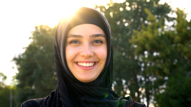 close-up of pretty young islamic woman - happy human face stock videos & royalty-free footage