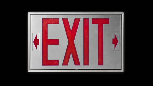 close-up of red exit sign on black background - blinking arrow stock videos & royalty-free footage
