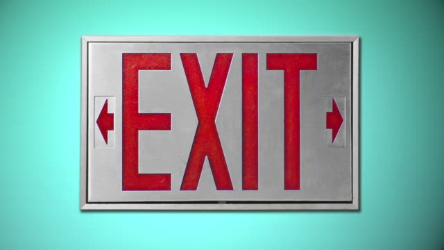 close-up of red exit sign on blue background - blinking arrow stock videos & royalty-free footage
