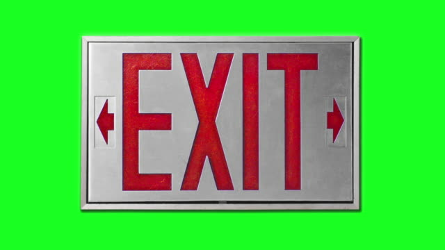 close-up of red exit sign on chroma key background - blinking arrow stock videos & royalty-free footage