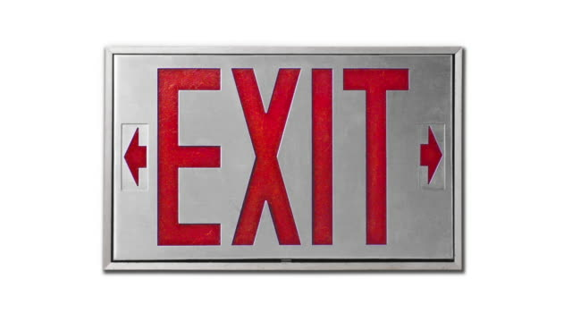 close-up of red exit sign on white background - blinking arrow stock videos & royalty-free footage