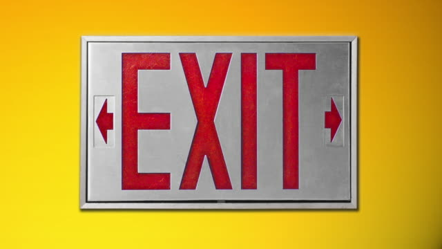 close-up of red exit sign on yellow background - blinking arrow stock videos & royalty-free footage