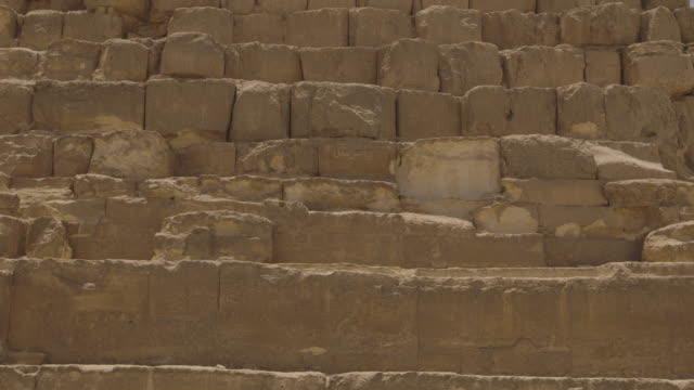 Close-up of red granite blocks at the base of one of the pyramids at Giza, Egypt.