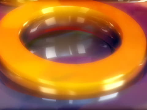 close-up of rings floating on liquid - ripetizione video stock e b–roll