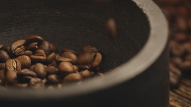 close-up of roasted beans falling in container - coffee drink stock videos & royalty-free footage