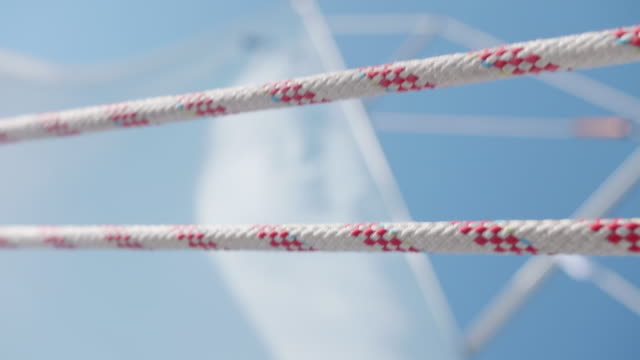 close-up of ropes while sailing a sailboat in the aegean sea of greece. - motorboot stock-videos und b-roll-filmmaterial