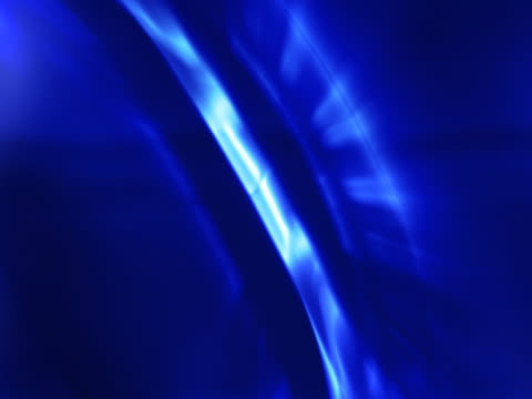 close-up of rotating blue ringsspinning discs of blue light as looping background - getönt stock-videos und b-roll-filmmaterial