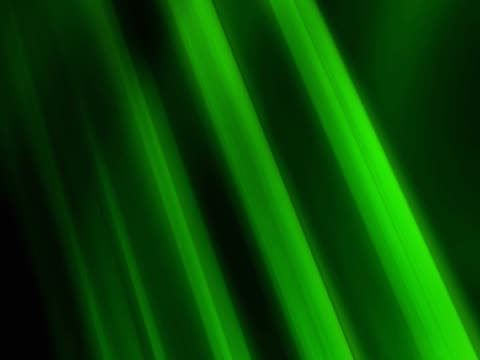 close-up of rotating raysspinning green lines as looping background - getönt stock-videos und b-roll-filmmaterial