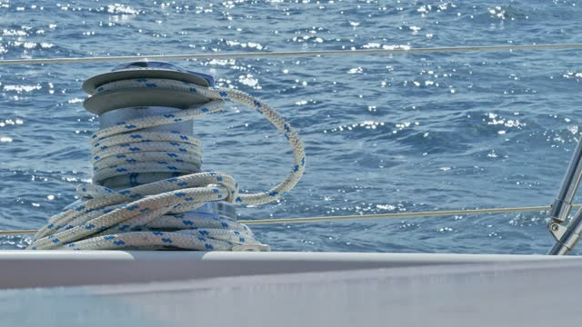 close-up of sail boat winch with rope while sailing in the atlantic ocean - yachting stock videos & royalty-free footage