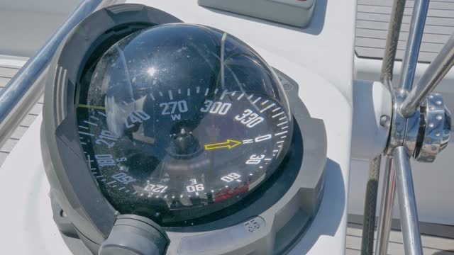 close-up of sailboat magnetic compass heading south-west - direction stock videos & royalty-free footage