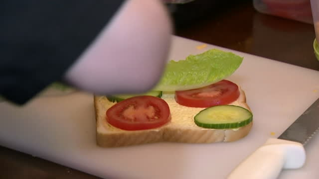 close-up of sandwiches being prepared and packed - tomato stock videos & royalty-free footage
