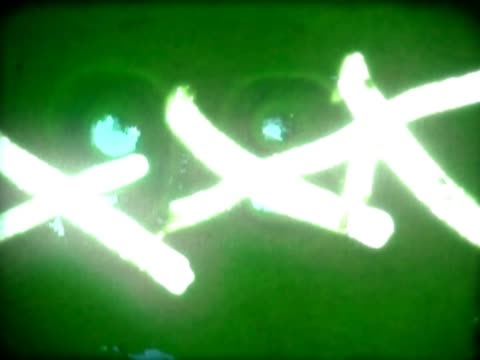 stockvideo's en b-roll-footage met close-up of scribbles and dust on a film leader - achterstevoren